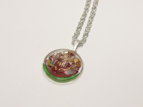 Necklace with glass button